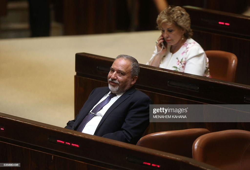 Former Israeli foreign minister and ultra-nationalist MP Avigdor Lieberman (L) is seen during a session of the Israeli parliament in which MPs are debating whether to approve his appointment as defence minister, on May 30, 2016 in Jerusalem. Israeli Prime Minister Benjamin Netanyahu's cabinet voted to expand his coalition and appoint hardliner Avigdor Lieberman as defence minister, bringing weeks of political intrigue -- and outrage -- towards a close. Parliament was expected later today to approve the appointment of Lieberman, a former foreign minister and ultra-nationalist who has pledged harsh measures against Palestinian 'terrorists'. KAHANA