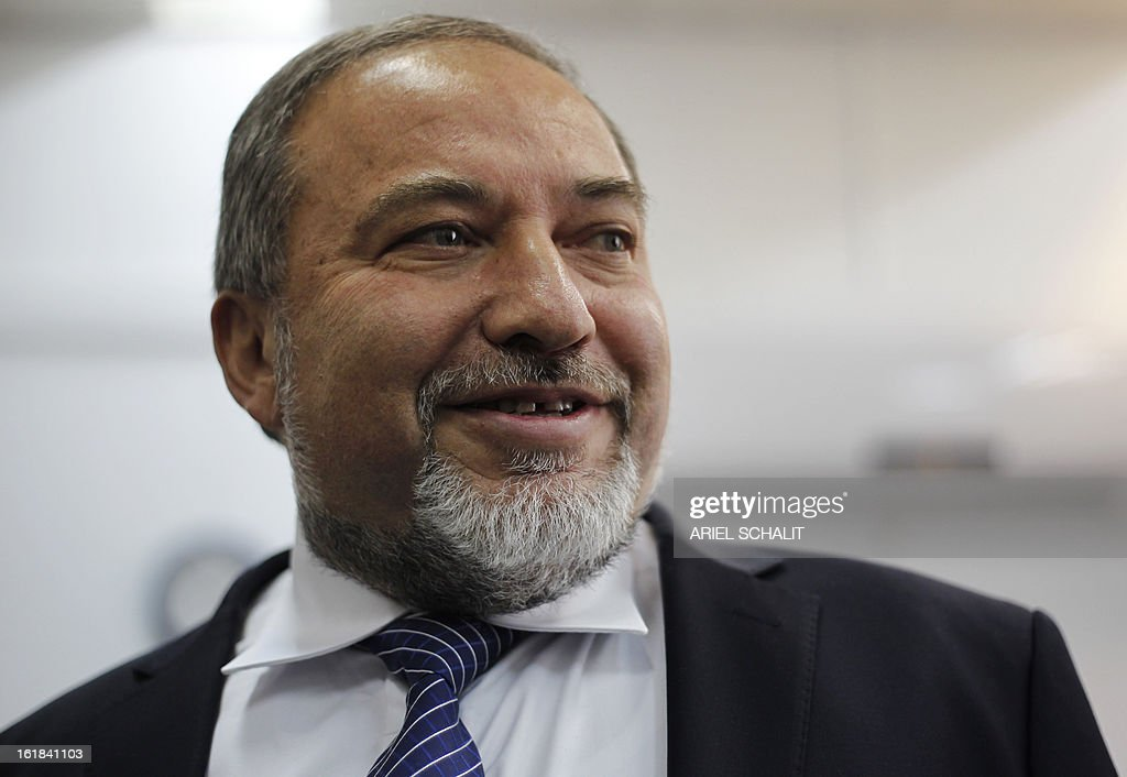 Former Israeli foreign minister Avigdor Lieberman arrives in the audience room of Jerusalem Magistrate's Court for the opening of his trail in which he is facing charges of fraud and breach of trust on February 17, 2013. The opening hearing before a panel of three judges was to begin at 1200 GMT, with Lieberman expressing confidence that he will be cleared of all charges and will return to resume his job as foreign minister. AFP PHOTO/POOL ARIEL SCHALIT