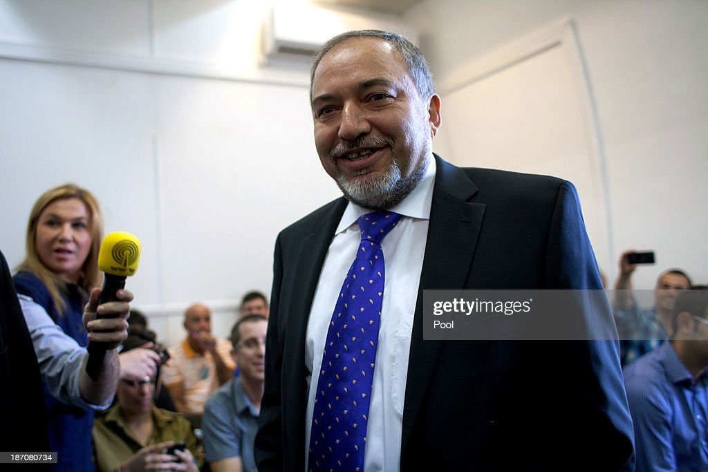 Former Israeli Foreign Minister, <a gi-track='captionPersonalityLinkClicked' href=/galleries/search?phrase=Avigdor+Lieberman&family=editorial&specificpeople=652650 ng-click='$event.stopPropagation()'>Avigdor Lieberman</a> arrives in the courtroom to hear the verdict in his trial in which is he is facing charges of fraud and breach of trust, at Jerusalem Magistrates Court on November 6, 2013 in Jerusalem, Israel. Concerning incidents which took place more than a decade ago, Lieberman was accused of trying to advance the career of a former diplomat who relayed information to him about a since closed criminal investigation into his business dealings. Lieberman was unanimously acquitted by a panel of three judges in a hearing which lasted just a few minutes.