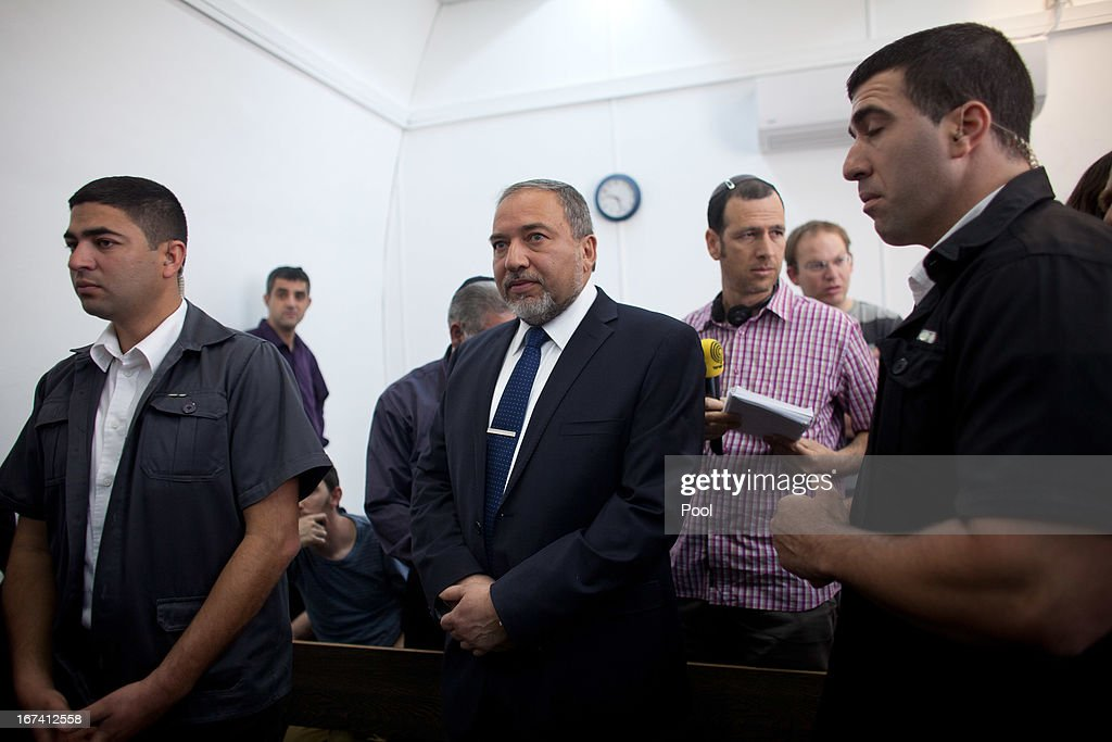 Former Israeli foreign minister Avigdor Lieberman (C) arrives to the magistrate court for the continuation of his trial on April 25, 2013 in Jerusalem, Israel. Concerning incidents which took place more than a decade ago, Lieberman is accused of trying to advance the career of a former diplomat who relayed information to him about a since closed criminal investigation into his business dealings. Lieberman pleaded not guilty on all counts, expressing confidence that he will be cleared of all charges so that he may resume his role as Foreign Minister.