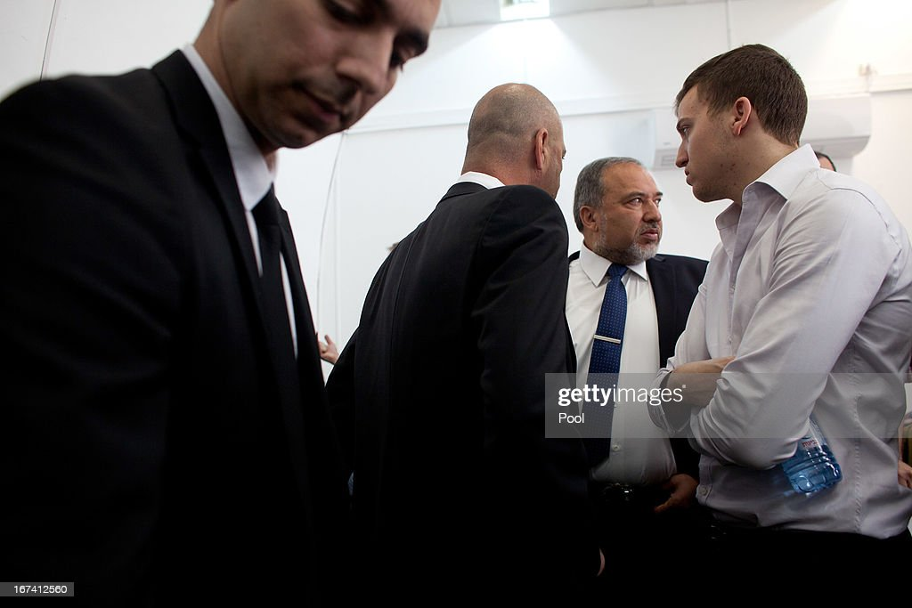 Former Israeli foreign minister Avigdor Lieberman (2R) arrives to the magistrate court for the continuation of his trial on April 25, 2013 in Jerusalem, Israel. Concerning incidents which took place more than a decade ago, Lieberman is accused of trying to advance the career of a former diplomat who relayed information to him about a since closed criminal investigation into his business dealings. Lieberman pleaded not guilty on all counts, expressing confidence that he will be cleared of all charges so that he may resume his role as Foreign Minister.