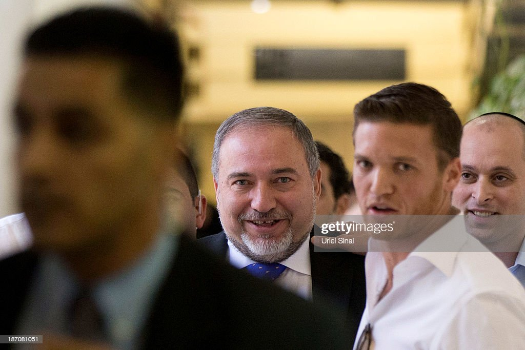 Former Israeli Foreign Minister <a gi-track='captionPersonalityLinkClicked' href=/galleries/search?phrase=Avigdor+Lieberman&family=editorial&specificpeople=652650 ng-click='$event.stopPropagation()'>Avigdor Lieberman</a> (C) as he exits the courtroom after hearing the verdict in his trial in which is he is facing charges of fraud and breach of trust, at Jerusalem Magistrates Court on November 6, 2013 in Jerusalem, Israel. Concerning incidents which took place more than a decade ago, Lieberman was accused of trying to advance the career of a former diplomat who relayed information to him about a since closed criminal investigation into his business dealings. Lieberman was unanimously acquitted by a panel of three judges in a hearing which lasted just a few minutes.