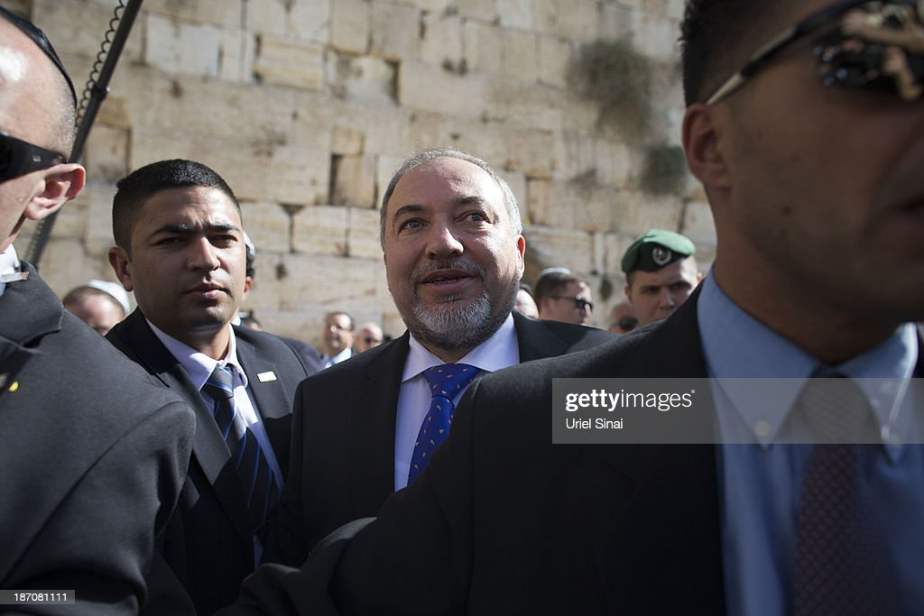 Former Israeli Foreign Minister, <a gi-track='captionPersonalityLinkClicked' href=/galleries/search?phrase=Avigdor+Lieberman&family=editorial&specificpeople=652650 ng-click='$event.stopPropagation()'>Avigdor Lieberman</a> is surrounded by supporters and security as he visits the Western wall after the verdict on charges of fraud and breach of trust was given on November 6, 2013 in Jerusalem, Israel. Concerning incidents which took place more than a decade ago, Lieberman was accused of trying to advance the career of a former diplomat who relayed information to him about a since closed criminal investigation into his business dealings. Lieberman was unanimously acquitted by a panel of three judges in a hearing which lasted just a few minutes.