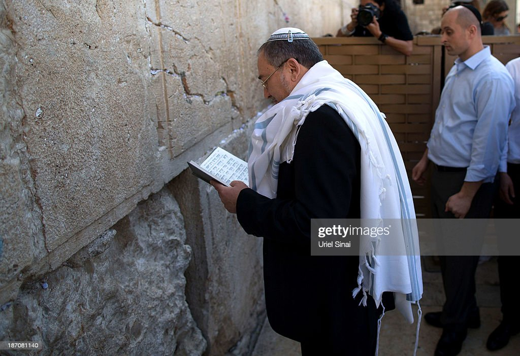 Former Israeli Foreign Minister <a gi-track='captionPersonalityLinkClicked' href=/galleries/search?phrase=Avigdor+Lieberman&family=editorial&specificpeople=652650 ng-click='$event.stopPropagation()'>Avigdor Lieberman</a> prays at the Western wall after the verdict on charges of fraud and breach of trust was given on November 6, 2013 in Jerusalem, Israel. Concerning incidents which took place more than a decade ago, Lieberman was accused of trying to advance the career of a former diplomat who relayed information to him about a since closed criminal investigation into his business dealings. Lieberman was unanimously acquitted by a panel of three judges in a hearing which lasted just a few minutes.