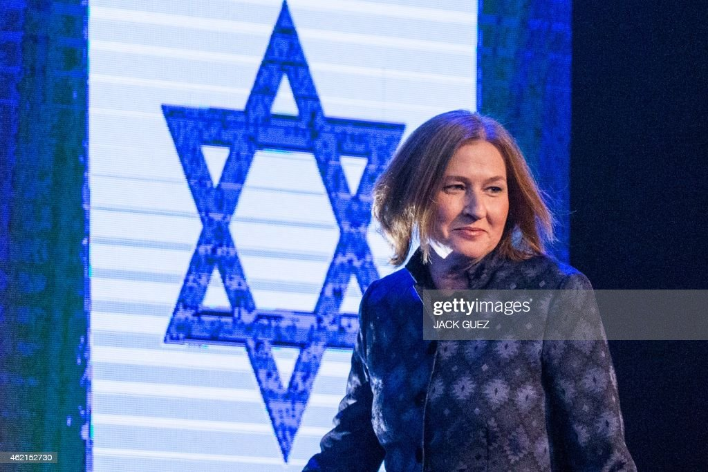 Former Israeli justice minister and HaTnuah party leader <a gi-track='captionPersonalityLinkClicked' href=/galleries/search?phrase=Tzipi+Livni&family=editorial&specificpeople=537394 ng-click='$event.stopPropagation()'>Tzipi Livni</a> arrives to deliver a speech during an election campaign meeting in Tel Aviv, on January 25, 2015 ahead of the March 17 general elections. Oposition Labour party head Isaac Herzog and Livni have made an alliance to contest Israel's snap general election. Most Israelis would like to see Prime Minister Benjamin Netanyahu replaced after March elections but, paradoxically, he is seen as most suitable for the job, an opinion poll said on December 18, 2014. AFP PHOTO / JACK GUEZ