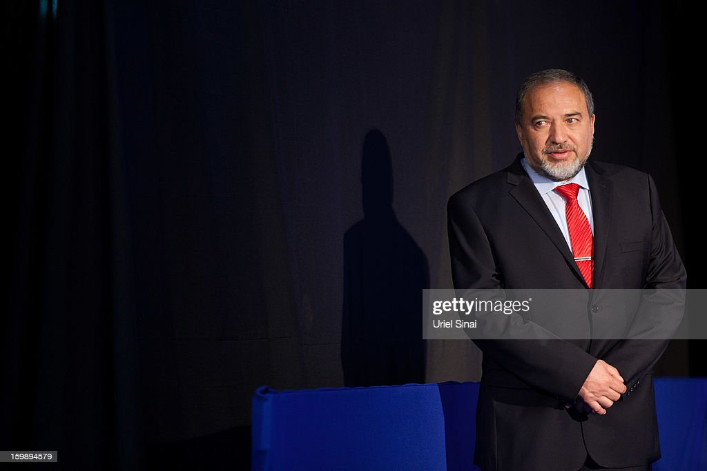 Former Israeli Minister for Foreign Affairs Avigdor Liberman visits the Likud party election campaign headquarters with Israeli Prime Minister Benjamin Netanyahu (not pictured) on Janurary 23, 2013 in Tel Aviv, Israel. Exit polls suggested that current Prime Minister Benjamin Netanyahu will return to office, although he performed worse than expected.