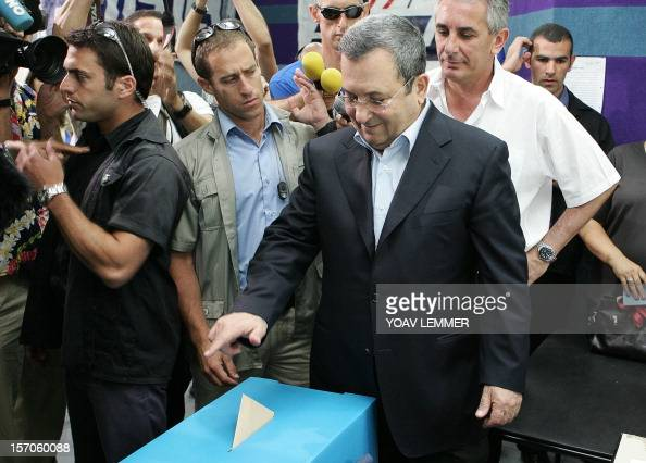 Former Israeli prime minister Ehud Barak drops his ballot in the box 12 June 2007 at a polling station in Kfar Saba close to Tel Aviv during the...
