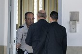 TOPSHOT Former Israeli Prime Minister Ehud Olmert arrives at the Maasiyahu Prison in the central Israeli city of Ramle on February 15 2016 as he...