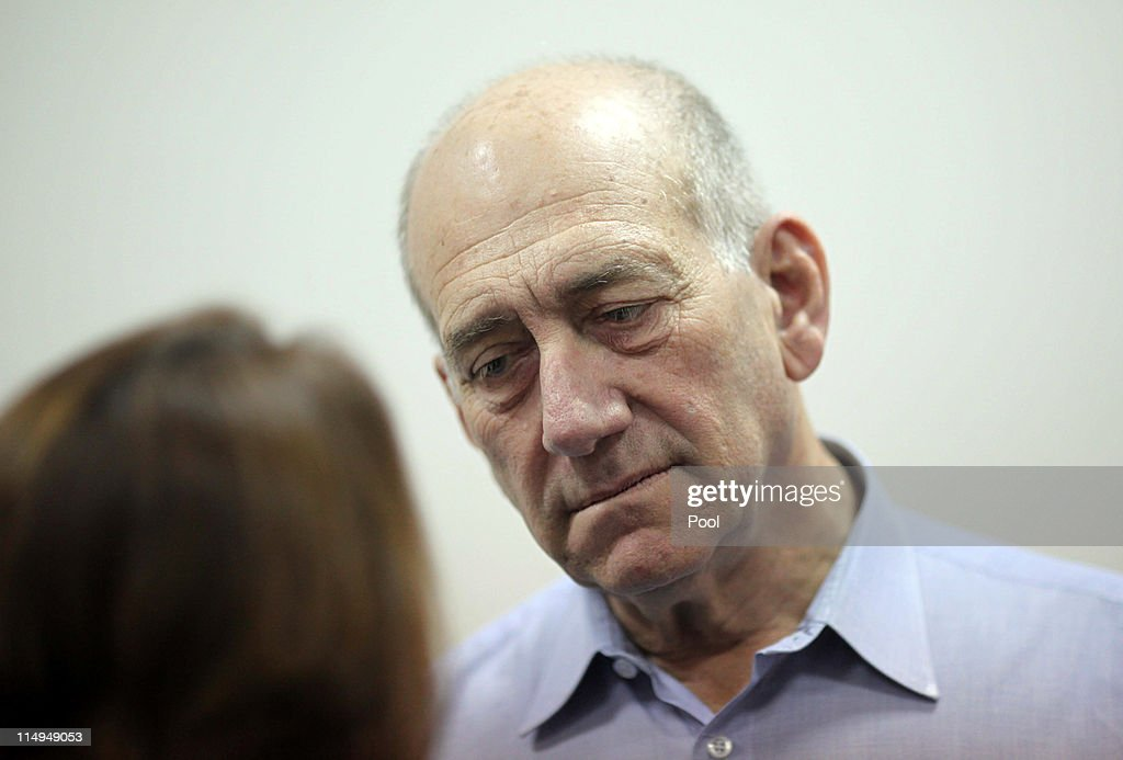 Former Israeli Prime Minister <a gi-track='captionPersonalityLinkClicked' href=/galleries/search?phrase=Ehud+Olmert&family=editorial&specificpeople=178946 ng-click='$event.stopPropagation()'>Ehud Olmert</a> arrives for the beginning of his corruption trail at the Jerusalem District Court on May 31, 2011 in Jerusalem, Israel. Olmert took the stand as the first witness, opening the defense phase of the trial.