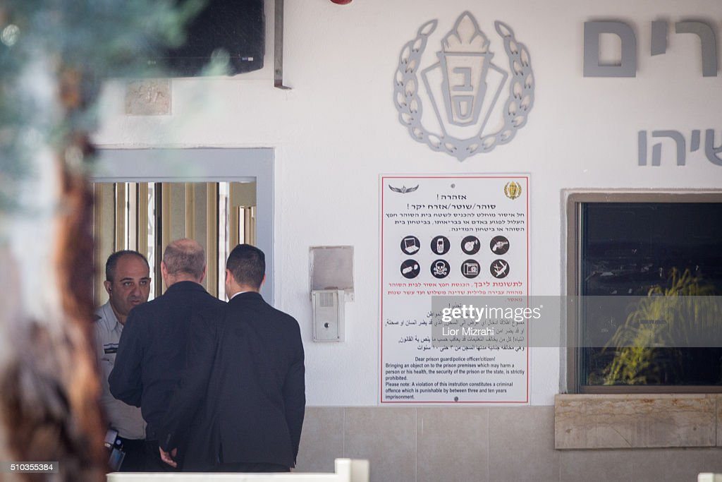 Former Israeli Prime Minister <a gi-track='captionPersonalityLinkClicked' href=/galleries/search?phrase=Ehud+Olmert&family=editorial&specificpeople=178946 ng-click='$event.stopPropagation()'>Ehud Olmert</a> (L), escorted by security personnel, arrives at Maasiyahu Prison on February 15, 2016 in Ramle, Israel. Olmert, Israeli Prime Minister from 2006 to 2009, arrived at Maasiyahu prison on Monday to begin a 19-month sentence for bribery and obstruction of justice convictions.