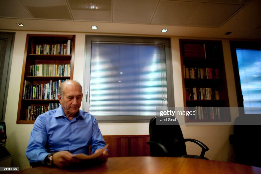Former Israeli Prime Minister <a gi-track='captionPersonalityLinkClicked' href=/galleries/search?phrase=Ehud+Olmert&family=editorial&specificpeople=178946 ng-click='$event.stopPropagation()'>Ehud Olmert</a> poses for photographers after delivering a public statement at his office on April 15, 2010 in Tel Aviv, Israel. Olmert delivered his statement amid allegations of corruption and bribery relating to the Holyland complex in Jerusalem and was today identified by the police as a suspect in the scandal.