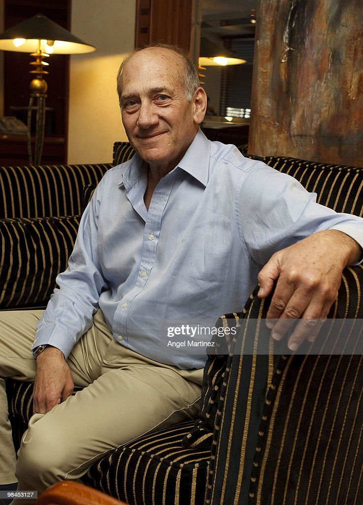 Former Israeli Prime Minister <a gi-track='captionPersonalityLinkClicked' href=/galleries/search?phrase=Ehud+Olmert&family=editorial&specificpeople=178946 ng-click='$event.stopPropagation()'>Ehud Olmert</a> poses on April 10, 2010 in Madrid, Spain. Olmert is reported to be cutting short a European vacation to answer questions in Israel about an alleged bribery scandal involving a former business partner.