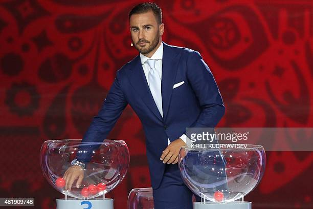 Former Italian defender and captain Fabio Cannavaro holds the preliminary draw for the Confederation of North Central American and Caribbean...