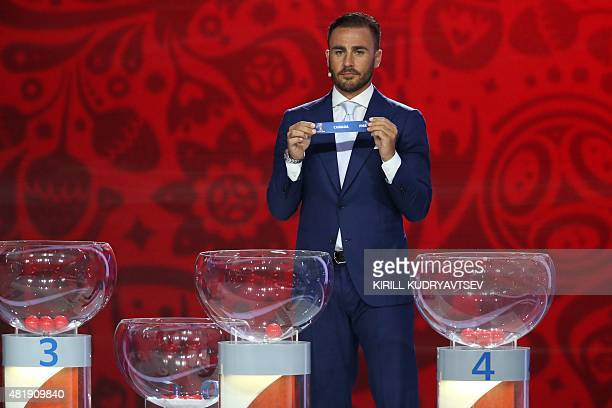 Former Italian defender and captain Fabio Cannavaro shows the name of Canada during the preliminary draw for the Confederation of North Central...