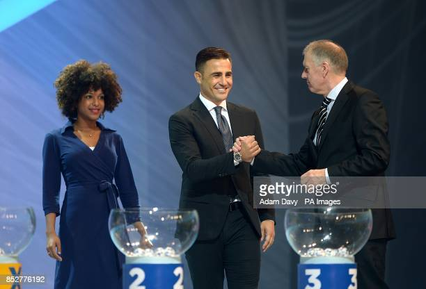 Former Italian footballer Fabio Cannavaro and former English footballer Geoff Hurst shake hands during the FIFA 2014 World Cup Draw at the Costa Do...