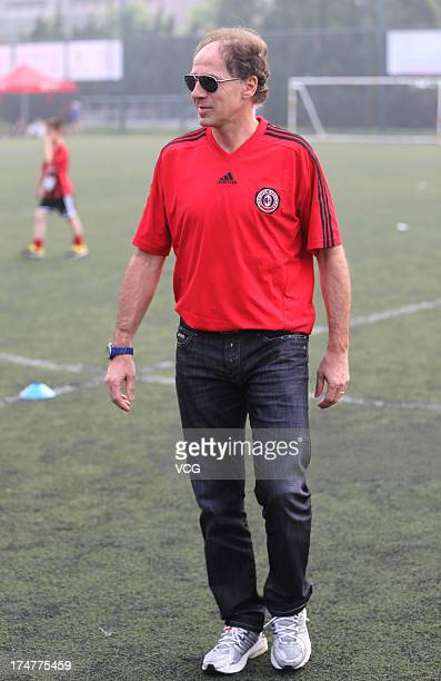 Former Italian footballer Franco Baresi attends the opening ceremony of AC Milan Football Summer Camp at Tiantai Stadium on July 29 2013 in Qingdao...
