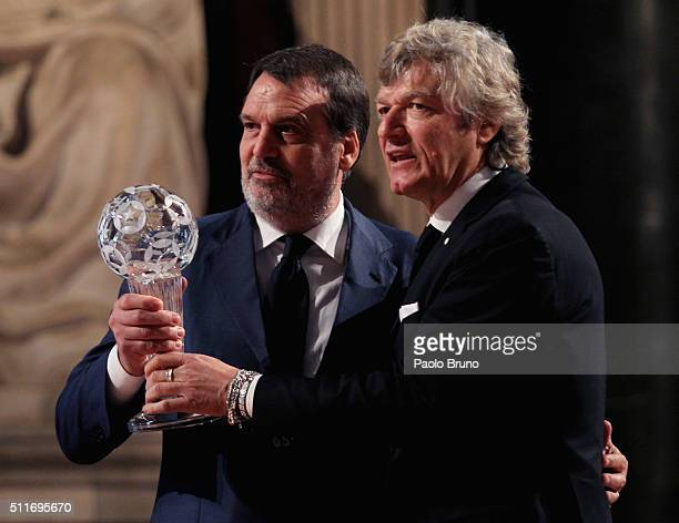 Former Italian National players Marco Tardelli and Giancarlo Antognoni pose showing the award during the Italian Football Federation Hall of Fame...