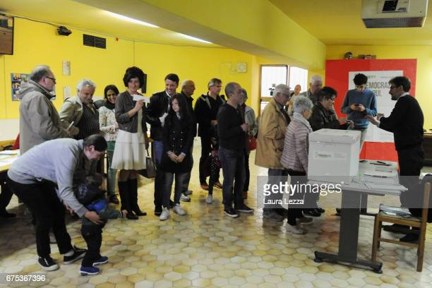 Former Italian Prime Minister and PD secretary Matteo Renzi queueing with his wife Agnese Renzi to cast his vote for Democratic Party leadership...