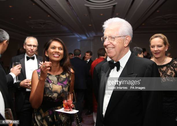 Former Italian Prime Minister Mario Monti and Gina Miller attend the Foreign Press Association Media Awards at the Sheraton Grand hotel in London