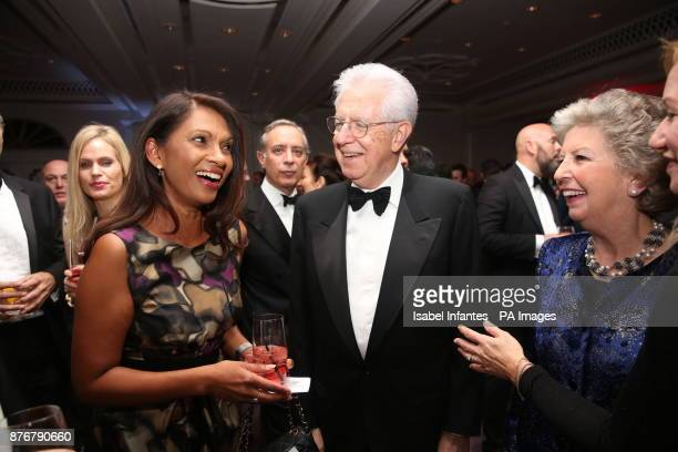 Former Italian Prime Minister Mario Monti his wife Elsa Antonioli and Gina Miller attend the Foreign Press Association Media Awards at the Sheraton...