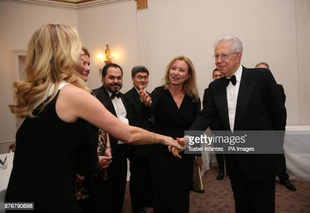 Former Italian Prime Minister Mario Monti is introduced to guests by Foreign Press Association president Deborah Bonetti as he attends the...