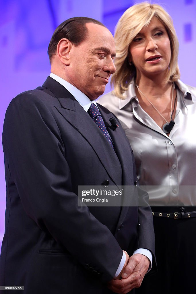 Former Italian Prime Minister Silvio Berlusconi (L) and Tv conductor Myrta Merlino (R) attend 'L'Aria Che Tira' TV show on February 4, 2013 in Rome, Italy. Silvio Berlusconi has announced yesterday that if the PDL party (People of the Liberty) win the elections scheduled for February 24, they will return the tax to families introduced by the government of Mario Monti.