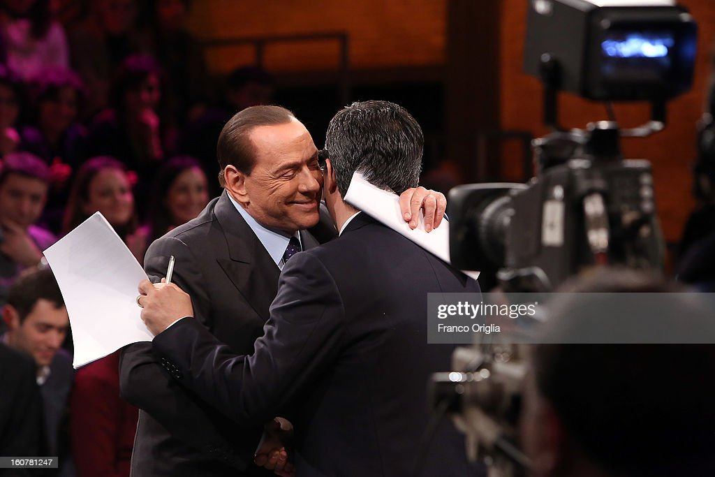 Former Italian Prime Minister <a gi-track='captionPersonalityLinkClicked' href=/galleries/search?phrase=Silvio+Berlusconi&family=editorial&specificpeople=201842 ng-click='$event.stopPropagation()'>Silvio Berlusconi</a> (L) and Tv conductor Giovanni Floris (R) attend 'Ballaro' Italian TV talk show on February 5, 2013 in Rome, Italy. <a gi-track='captionPersonalityLinkClicked' href=/galleries/search?phrase=Silvio+Berlusconi&family=editorial&specificpeople=201842 ng-click='$event.stopPropagation()'>Silvio Berlusconi</a> has announced on Sunday that if the PDL party (People of the Liberty) win the elections scheduled for February 24, they will return the tax to families introduced by the government of Mario Monti.