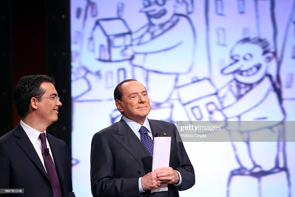 Former Italian Prime Minister Silvio Berlusconi (R) and Tv conductor Giovanni Floris (L) attend 'Ballaro' Italian TV talk show on February 5, 2013 in Rome, Italy. Silvio Berlusconi has announced on Sunday that if the PDL party (People of the Liberty) win the elections scheduled for February 24, they will return the tax to families introduced by the government of Mario Monti.