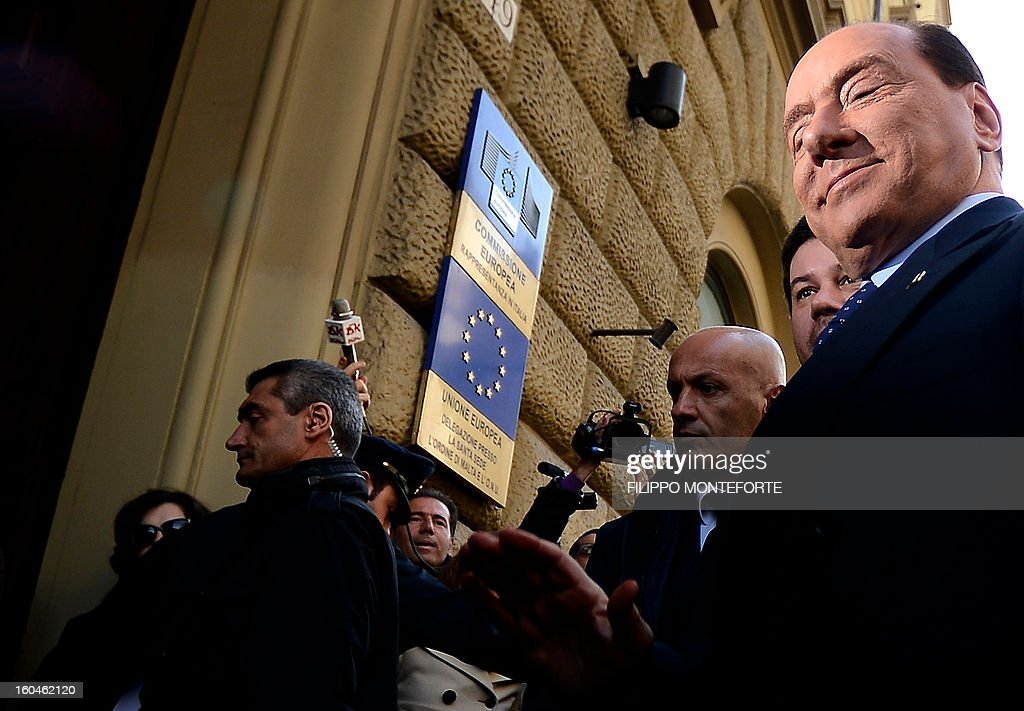 Former Italian Prime Minister Silvio Berlusconi (R) arrives for a meeting of the Popolo della Liberta (PDL) with the European's People's party (PPE) on February 1, 2013 in Rome. AFP PHOTO/ Filippo MONTEFORTE