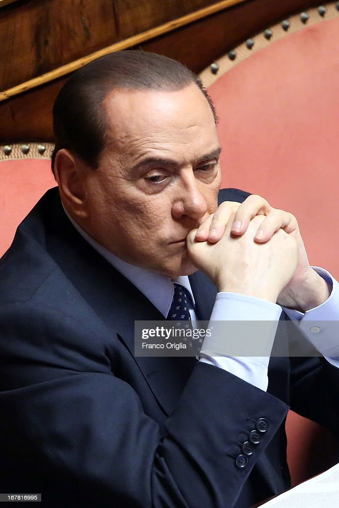 Former Italian Prime Minister <a gi-track='captionPersonalityLinkClicked' href=/galleries/search?phrase=Silvio+Berlusconi&family=editorial&specificpeople=201842 ng-click='$event.stopPropagation()'>Silvio Berlusconi</a> attends the confidence vote at the Senate on April 30, 2013 in Rome, Italy. The new coalition government was formed through extensive cooperation agreements between the right and left coalitions after a two-month long post-election deadlock.