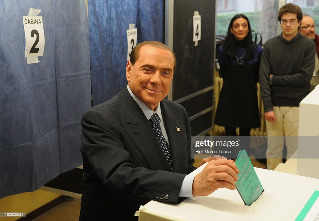 Former Italian Prime Minister <a gi-track='captionPersonalityLinkClicked' href=/galleries/search?phrase=Silvio+Berlusconi&family=editorial&specificpeople=201842 ng-click='$event.stopPropagation()'>Silvio Berlusconi</a> casts his vote in a polling station on February 24, 2013 in Milan, Italy. Italians are heading to the polls today to vote in the elections, as the country remains in the grip of economic problems. Pier Luigi Bersani's centre-left alliance is believed to be a few points ahead of the centre-right bloc led by ex-Prime Minister <a gi-track='captionPersonalityLinkClicked' href=/galleries/search?phrase=Silvio+Berlusconi&family=editorial&specificpeople=201842 ng-click='$event.stopPropagation()'>Silvio Berlusconi</a>.