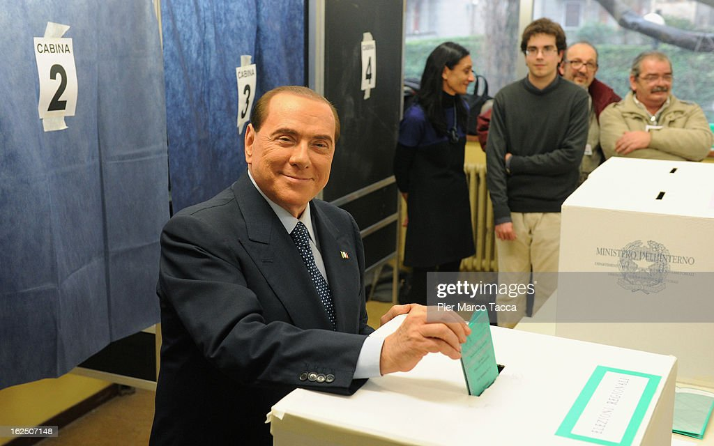 Former Italian Prime Minister Silvio Berlusconi casts his vote in a polling station on February 24, 2013 in Milan, Italy. Italians are heading to the polls today to vote in the elections, as the country remains in the grip of economic problems. Pier Luigi Bersani's centre-left alliance is believed to be a few points ahead of the centre-right bloc led by ex-Prime Minister Silvio Berlusconi.