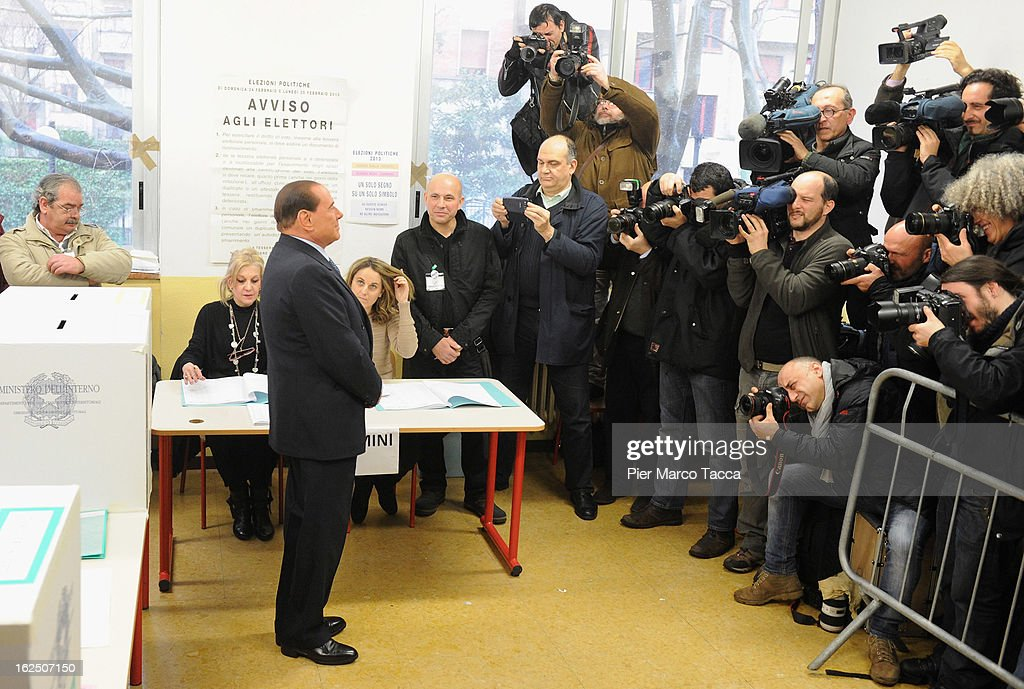 Former Italian Prime Minister Silvio Berlusconi faces the media as he casts his vote in a polling station on February 24, 2013 in Milan, Italy. Italians are heading to the polls today to vote in the elections, as the country remains in the grip of economic problems. Pier Luigi Bersani's centre-left alliance is believed to be a few points ahead of the centre-right bloc led by ex-Prime Minister Silvio Berlusconi.