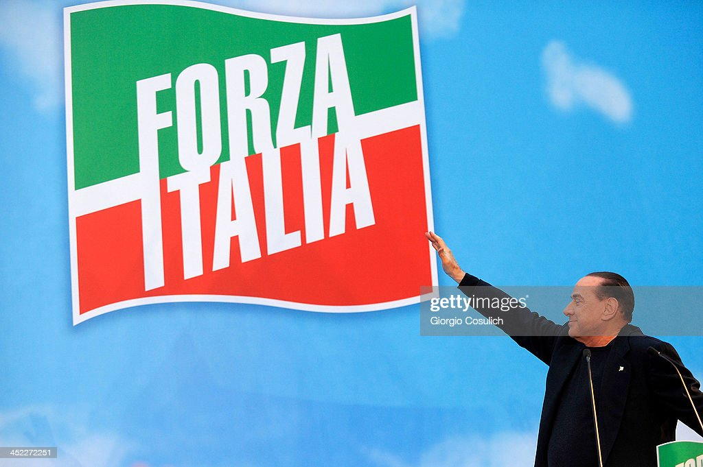 Former Italian Prime Minister Silvio Berlusconi gestures as he attends a rally outside his house, Palazzo Grazioli, on November 27, 2013 in Rome, Italy. The Italian Senate has today voted to expel former Prime Minister Silvio Berlsuconi from parliament after his recent conviction over tax fraud.