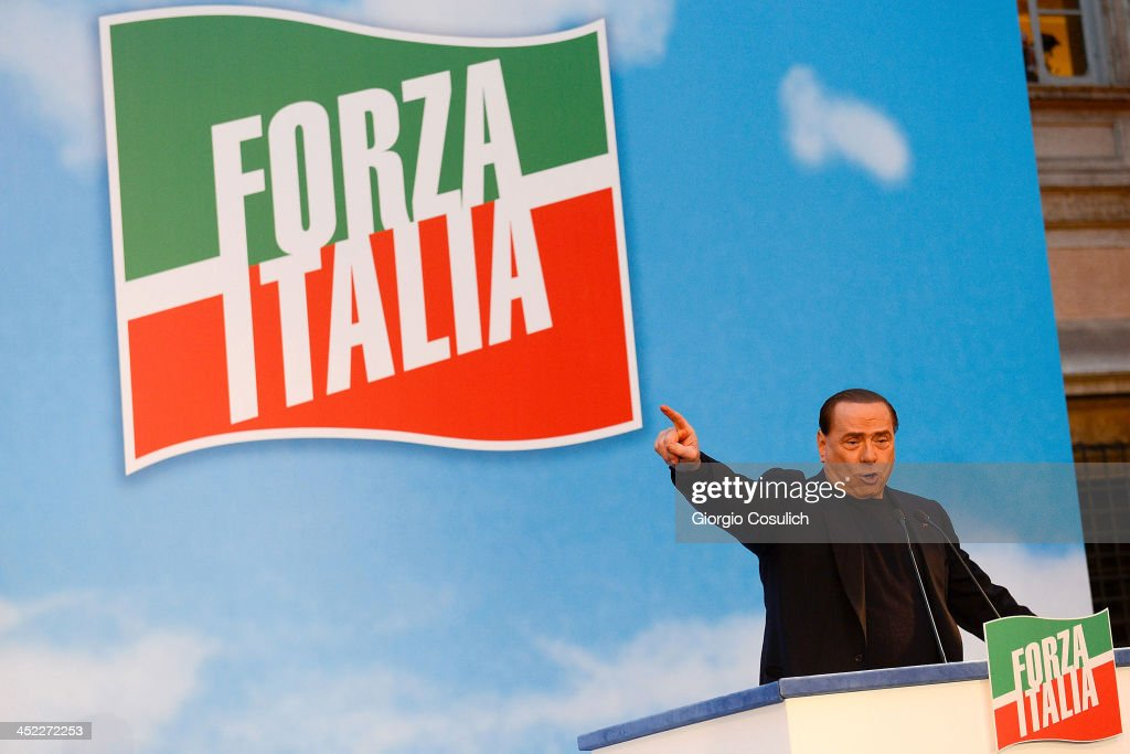 Former Italian Prime Minister <a gi-track='captionPersonalityLinkClicked' href=/galleries/search?phrase=Silvio+Berlusconi&family=editorial&specificpeople=201842 ng-click='$event.stopPropagation()'>Silvio Berlusconi</a> gestures as he attends a rally outside his house, Palazzo Grazioli, on November 27, 2013 in Rome, Italy. The Italian Senate has today voted to expel former Prime Minister Silvio Berlsuconi from parliament after his recent conviction over tax fraud.