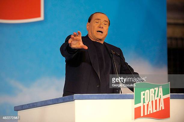 Former Italian Prime Minister Silvio Berlusconi gestures as he attends a rally outside his house Palazzo Grazioli on November 27 2013 in Rome Italy...