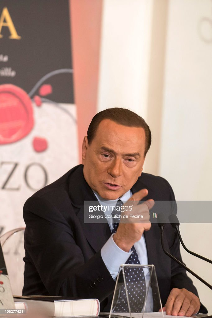 Former Italian Prime Minister <a gi-track='captionPersonalityLinkClicked' href=/galleries/search?phrase=Silvio+Berlusconi&family=editorial&specificpeople=201842 ng-click='$event.stopPropagation()'>Silvio Berlusconi</a> gestures as he attends the presentation of the book 'Il palazzo e la piazza' by tv journalist Bruno Vespa on December 12, 2012 in Rome, Italy. During the presentation of the book, <a gi-track='captionPersonalityLinkClicked' href=/galleries/search?phrase=Silvio+Berlusconi&family=editorial&specificpeople=201842 ng-click='$event.stopPropagation()'>Silvio Berlusconi</a> wanted to clarify his position as he said that he will be candidate to Palazzo Chigi as Prime Minister but he is ready to take a step back in case the Premier Mario Monti is a candidate in turn.