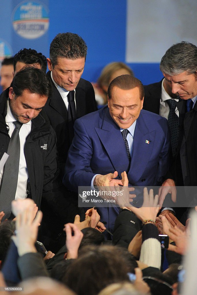 Former Italian Prime Minister <a gi-track='captionPersonalityLinkClicked' href=/galleries/search?phrase=Silvio+Berlusconi&family=editorial&specificpeople=201842 ng-click='$event.stopPropagation()'>Silvio Berlusconi</a> greets supporters during a political rally on February 18, 2013 in Milan, Italy. Berlusconi is entering the last week of campaigning for his party Popolo della Liberta. Italians go to the polls February 24-25.