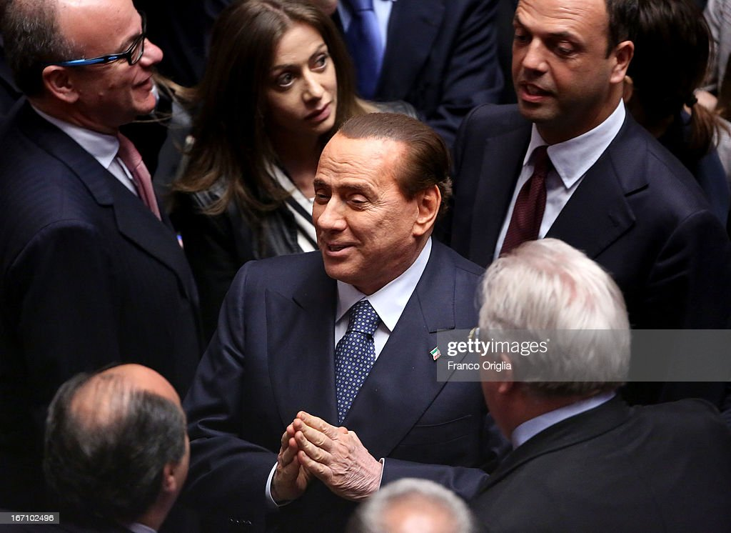 Former Italian Prime Minister <a gi-track='captionPersonalityLinkClicked' href=/galleries/search?phrase=Silvio+Berlusconi&family=editorial&specificpeople=201842 ng-click='$event.stopPropagation()'>Silvio Berlusconi</a> jubilates as Parliament votes for President of Republic on April 20, 2013 in Rome, Italy. After five ballots ended in deadlock the Italian Parliment has re-elected President Giorgio Napolitano for a second term following a last-minute deal between party chiefs.