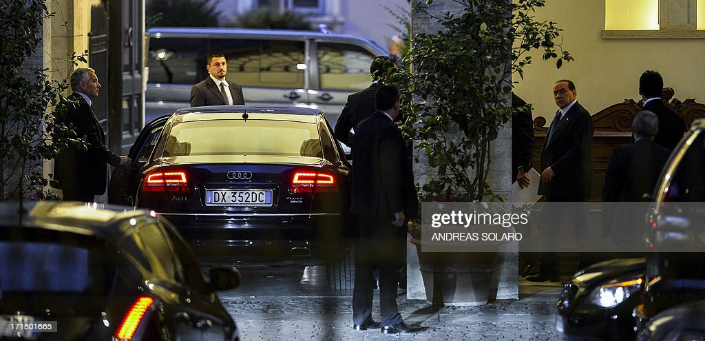 Former Italian Prime Minister Silvio Berlusconi looks on (3R) as he leaves Palazzo Grazioli (Berlusconi's residence), before his meeting with Italian Prime Minister Enrico Letta, on June 25, 2013 at Palazzo Chigi, the Italian Prime Ministry in Rome. Silvio Berlusconi's furious reaction to a conviction for paying for sex with an underage prostitute suggests a belligerent centre-right will intensify pressure on the coalition government to favour its policies, particularly concerning the hot-button issue of tax, analysts said Tuesday. Political observers had warned a guilty verdict could provoke the capricious former premier into pulling support from Enrico Letta's grand coalition, for failing to offer him legal protection. SOLARO