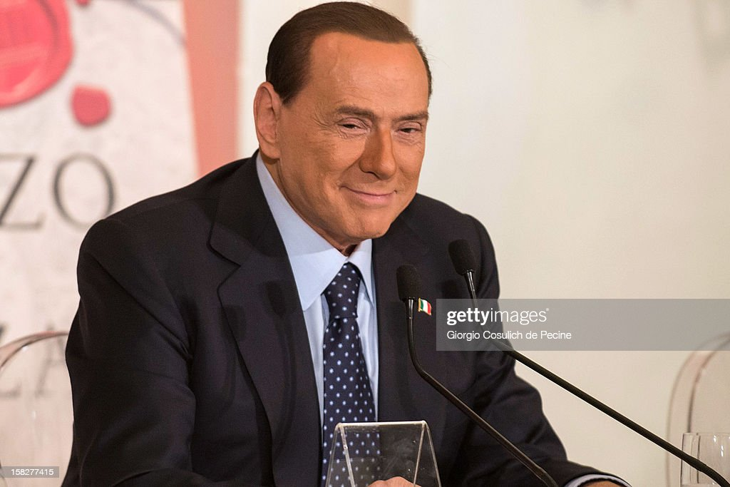 Former Italian Prime Minister <a gi-track='captionPersonalityLinkClicked' href=/galleries/search?phrase=Silvio+Berlusconi&family=editorial&specificpeople=201842 ng-click='$event.stopPropagation()'>Silvio Berlusconi</a> smiles as he attends the presentation of the book 'Il palazzo e la piazza' by tv journalist Bruno Vespa on December 12, 2012 in Rome, Italy. During the presentation of the book, <a gi-track='captionPersonalityLinkClicked' href=/galleries/search?phrase=Silvio+Berlusconi&family=editorial&specificpeople=201842 ng-click='$event.stopPropagation()'>Silvio Berlusconi</a> wanted to clarify his position as he said that he will be candidate to Palazzo Chigi as Prime Minister but he is ready to take a step back in case the Premier Mario Monti is a candidate in turn.