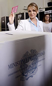 Former Italian Prime Minister Silvio Berlusconi's girlfriend Francesca Pascale prepares to cast her vote for the European Parliament elections at a...