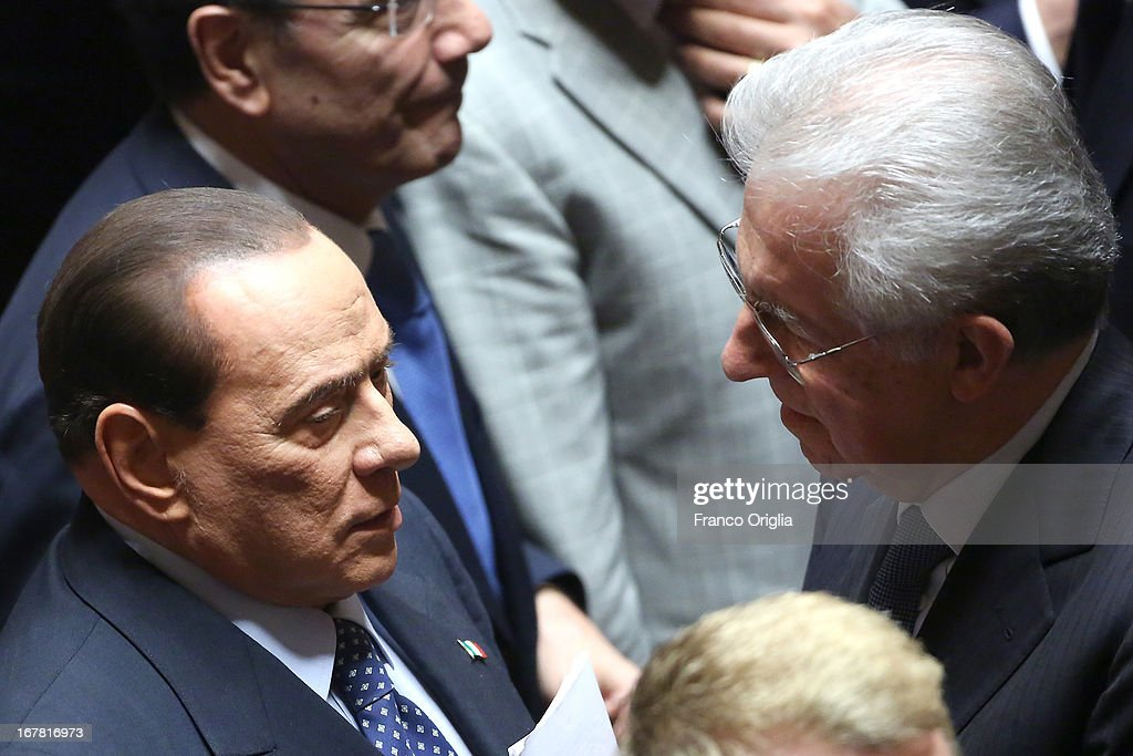 Former Italian Prime Ministers Mario Monti (R) and Silvio Berlusconi (L) attend the confidence vote at the Senate on April 30, 2013 in Rome, Italy. The new coalition government was formed through extensive cooperation agreements between the right and left coalitions after a two-month long post-election deadlock.
