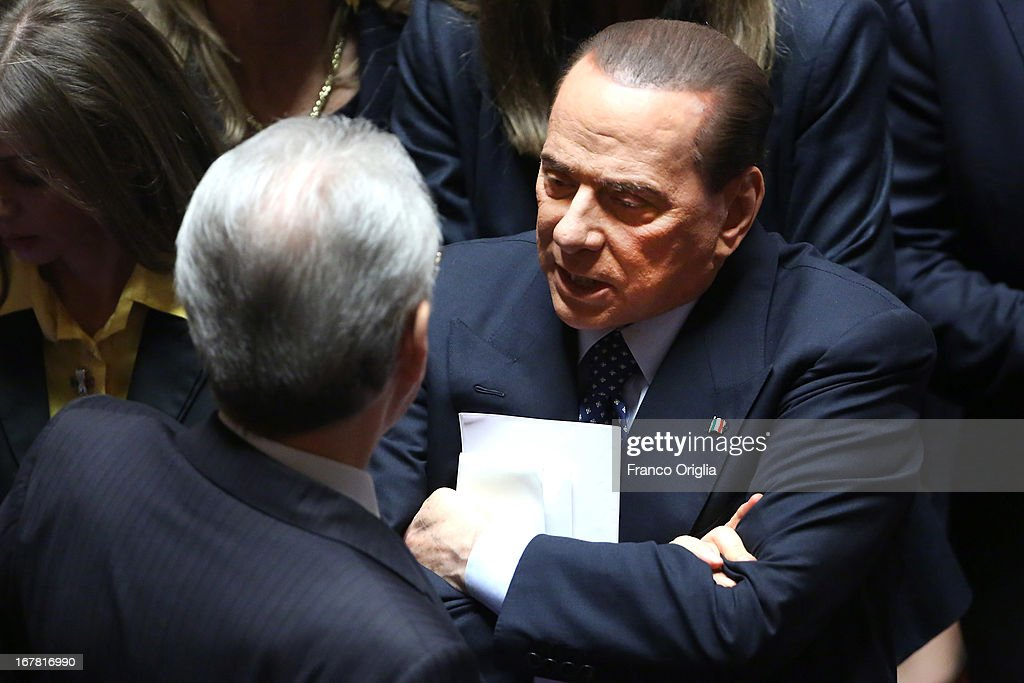 Former Italian Prime Ministers Mario Monti (L) and Silvio Berlusconi (R) attend the confidence vote at the Senate on April 30, 2013 in Rome, Italy. The new coalition government was formed through extensive cooperation agreements between the right and left coalitions after a two-month long post-election deadlock.