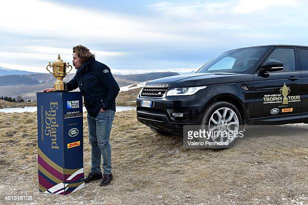 Former Italy captain Andrea Lo Cicero kisses with the Webb Ellis Cup in the Lessinia Mountains Verona as part of the Rugby World Cup Trophy Tour...