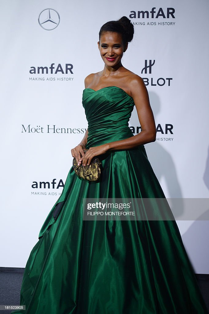 Former Italy's beauty queen Denny Mendez arrives to attend the amfAR Milano 2013 at La Permanente during Milan Fashion Week on September 21, 2013. AFP PHOTO / FILIPPO MONTEFORTE