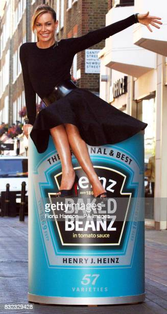 Former 'itgirl' Tara PalmerTomkinson sits on a large can of baked beans in London's Carnaby Street to launch the Heinz Baked Beans promotion inviting...