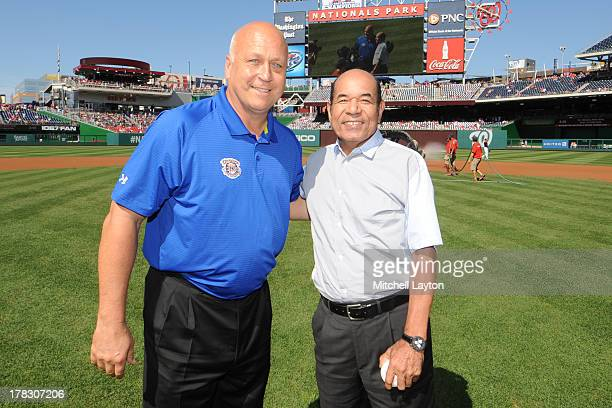 Former Japan ball player Sachio Kinugasa and American ball player Cal Ripken Jr pose before a baseball game between the San Francisco Giants and the...