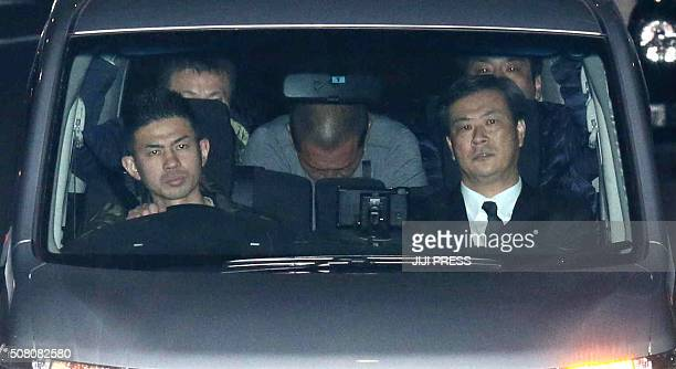 Former Japanese baseball star Kazuhiro Kiyohara is transported into the Tokyo metropolitan police headquarters early on February 3 2016 Former...