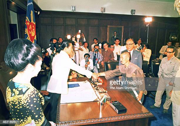 Former Japanese Imperial Army intelligent officer Hiroo Onoda shakes hands with Philippine President Ferdinand Marcos as Onoda finally surrendered on...